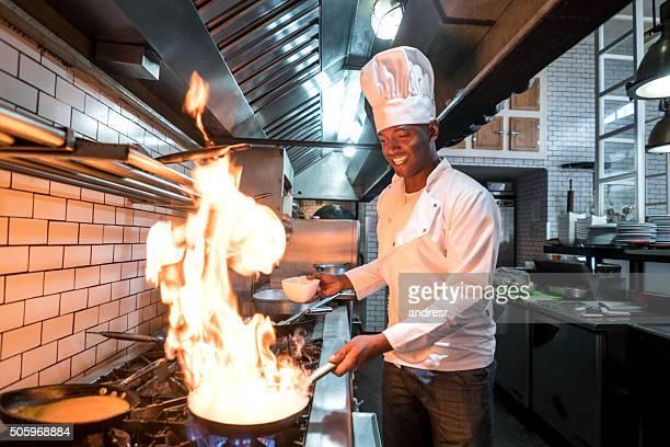 Chef flaming food at a restaurant