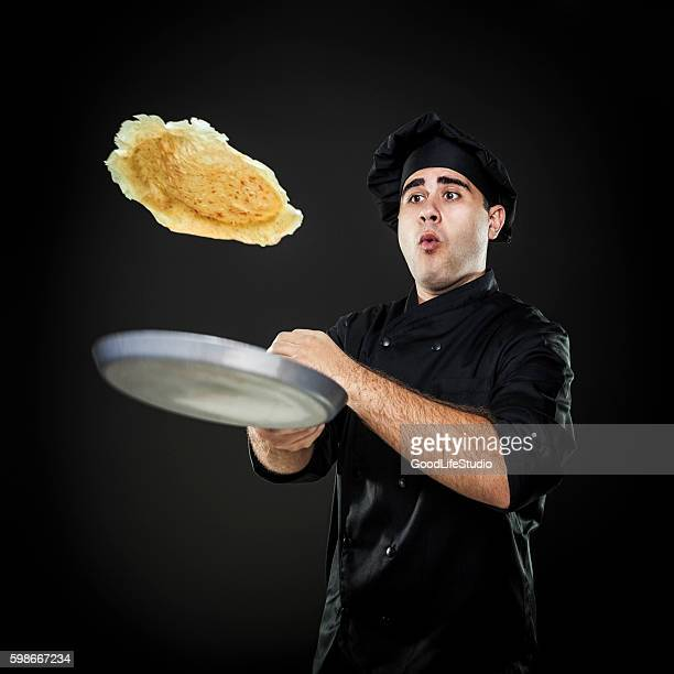 Chef flipping crepes