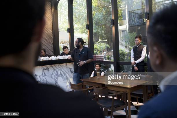Chef Gaggan Anand center left talks to employees at Gaggan restaurant in Bangkok Thailand on Friday May 5 2017 After his restaurant's third straight...