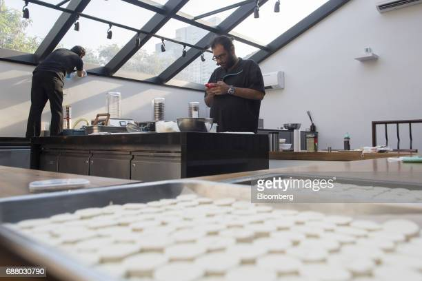 Chef Gaggan Anand center uses a smartphone in the research and development kitchen at Gaggan restaurant in Bangkok Thailand on Friday May 5 2017...