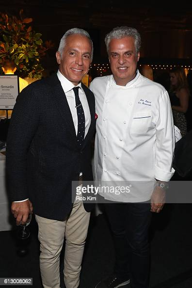 Chef Geoffrey Zakarian and Chef Eric Ripert attend City Harvest's 22nd Annual Bid Against Hunger at Pier 36 on October 6 2016 in New York City