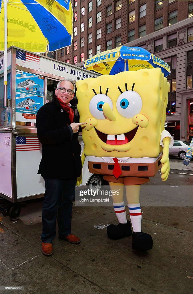 Chef Geoffrey Zakarian and SpongeBob SquarePants attend the Norwegian Warming Station launch in Times Square on January 28, 2013 in New York City.