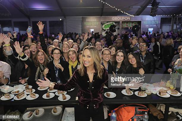 Chef Giada De Laurentiis poses with a guest at Barilla's Italian Table hosted by Giada De Laurentiis during the Food Network Cooking Channel New York...