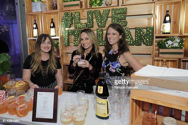 Chef Giada De Laurentiis poses with guests at Barilla's Italian Table hosted by Giada De Laurentiis during the Food Network Cooking Channel New York...