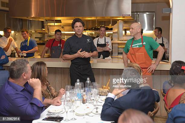Chef Giovanni Rocchio and Chef Marc Vetri present food at a Dinner Hosted By Marc Vetri And Giovanni Rocchio Part of the Taste Fort Lauderdale...