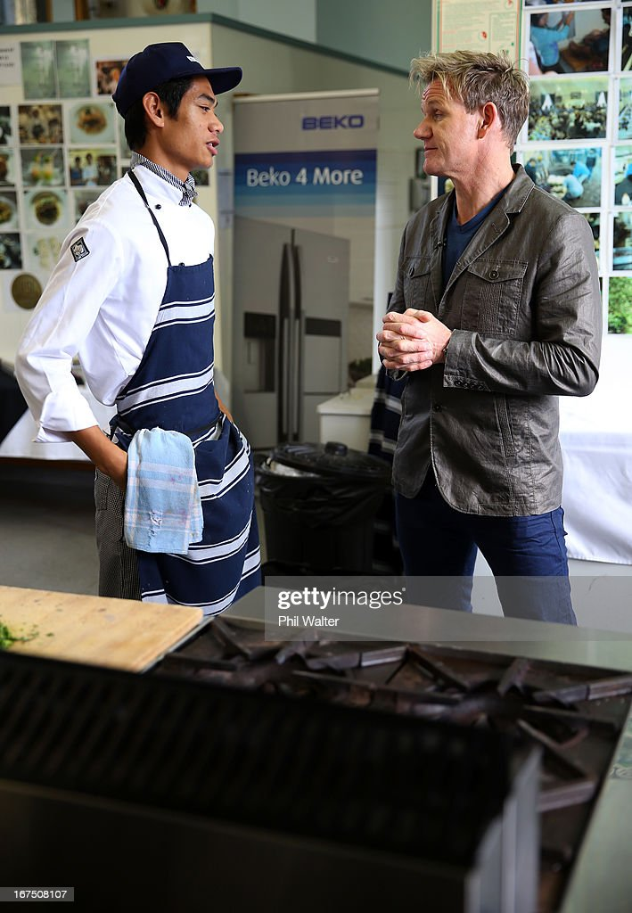 Chef <a gi-track='captionPersonalityLinkClicked' href=/galleries/search?phrase=Gordon+Ramsay&family=editorial&specificpeople=210520 ng-click='$event.stopPropagation()'>Gordon Ramsay</a> chats with student Antony Sua in the school kitchen during a visit to Papakura High School on April 26, 2013 in Auckland, New Zealand. Ramsay is in Auckland to host a fundraising Gala in support of The Rising Foundation dedication to helping at-risk youth in South Auckland.