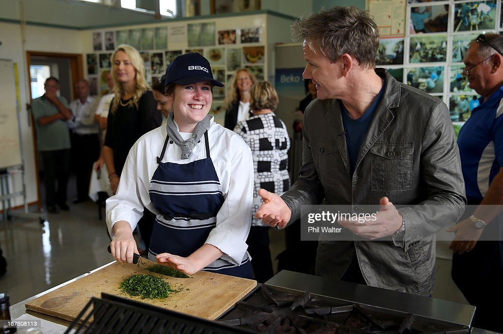 Chef <a gi-track='captionPersonalityLinkClicked' href=/galleries/search?phrase=Gordon+Ramsay&family=editorial&specificpeople=210520 ng-click='$event.stopPropagation()'>Gordon Ramsay</a> chats with student Jazmine Johnstone in the school kitchen during a visit to Papakura High School on April 26, 2013 in Auckland, New Zealand. Ramsay is in Auckland to host a fundraising Gala in support of The Rising Foundation dedication to helping at-risk youth in South Auckland.