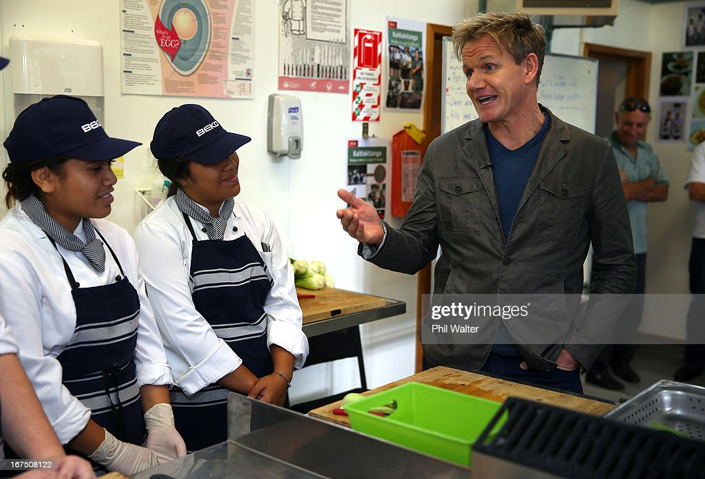 Chef <a gi-track='captionPersonalityLinkClicked' href=/galleries/search?phrase=Gordon+Ramsay&family=editorial&specificpeople=210520 ng-click='$event.stopPropagation()'>Gordon Ramsay</a> chats with students Hinerangi Isaac (L) and Stevie Ray (C) in the school kitchen during a visit to Papakura High School on April 26, 2013 in Auckland, New Zealand. Ramsay is in Auckland to host a fundraising Gala in support of The Rising Foundation dedication to helping at-risk youth in South Auckland.