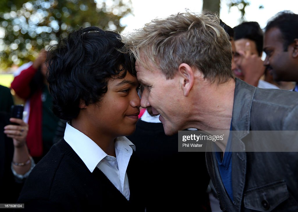 Chef <a gi-track='captionPersonalityLinkClicked' href=/galleries/search?phrase=Gordon+Ramsay&family=editorial&specificpeople=210520 ng-click='$event.stopPropagation()'>Gordon Ramsay</a> is greeted by a student with a traditional Maori greeting of a Hongi during a visit to Papakura High School on April 26, 2013 in Auckland, New Zealand. Ramsay is in Auckland to host a fundraising Gala in support of The Rising Foundation dedication to helping at-risk youth in South Auckland.
