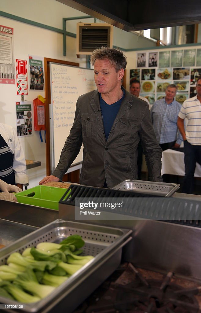 Chef <a gi-track='captionPersonalityLinkClicked' href=/galleries/search?phrase=Gordon+Ramsay&family=editorial&specificpeople=210520 ng-click='$event.stopPropagation()'>Gordon Ramsay</a> meets with students in the school kitchen during a visit to Papakura High School on April 26, 2013 in Auckland, New Zealand. Ramsay is in Auckland to host a fundraising Gala in support of The Rising Foundation dedication to helping at-risk youth in South Auckland.