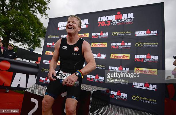 Chef Gordon Ramsay reacts after finishing Ironman 703 Staffordshire on June 14 2015 in Lichfield England