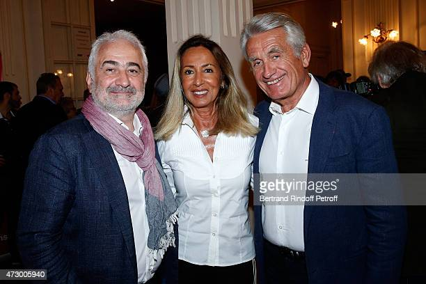 Chef Guy Savoy with Nicole and Gilbert Coullier attend the 'Open Space' Theater Play at Theatre de Paris on May 11 2015 in Paris France