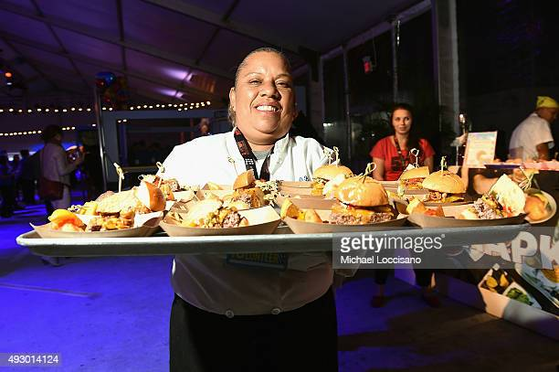 A chef hands out burgers during the Blue Moon Burger Bash presented by Pat LaFrieda Meats hosted by Rachael Ray Food Network Cooking Channel New York...