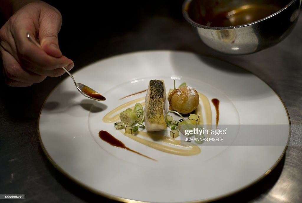 Chef Hendrik Otto Works On A Zander Menu In The Kitchen Of The Lorenz Adlon  Esszimmer