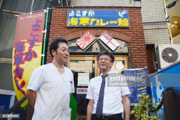 Chef Hideki Kurita and restaurant manager Toshiyuki Takahashi stand in front of their restaurant in the naval port city of Yokosuka in Kanagawa...