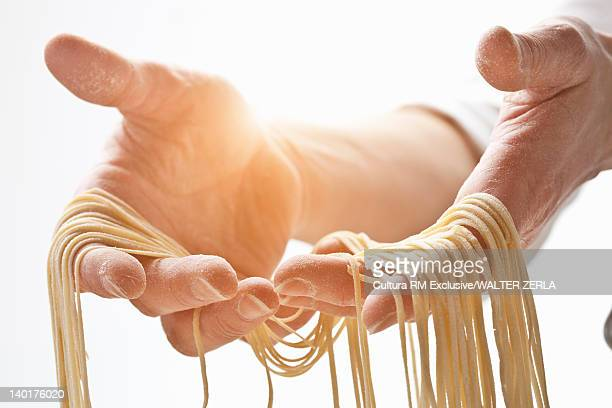 Chef holding fresh pasta dough