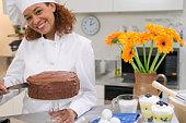 Chef icing chocolate cake