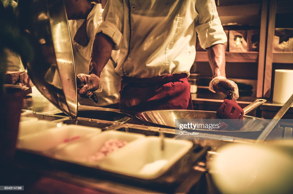 Busy Kitchen chef in a busy kitchen stock photo | getty images