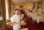 Chef in Dining Room of Kempinski Hotel