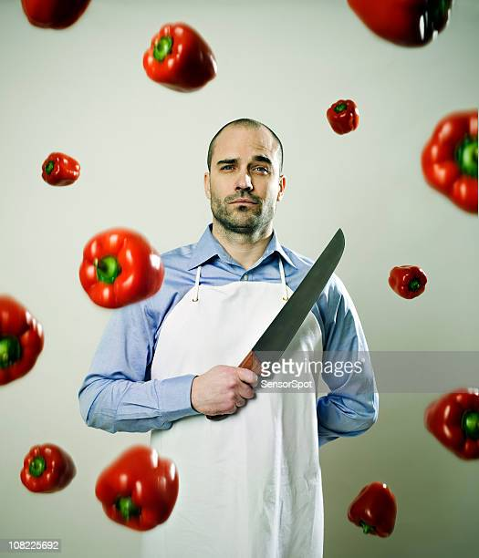 Chef in Kitchen with Falling Peppers