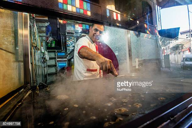 Chef in the eatery at Grand Bazaar Tehran Iran Iran is a diverse country consisting of many different religious and ethnic groups that are unified...