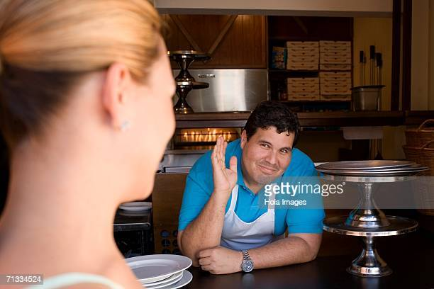 Chef interacting with customer.