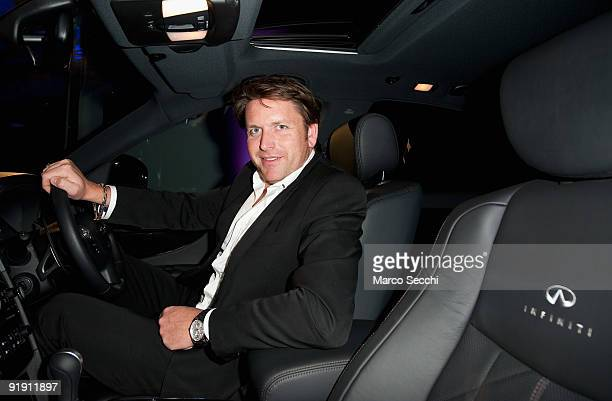 Chef James Martin sits in a FX50S while he attends the opening of the first Infiniti showroom in UK in Reading on October 15 2009 in London England...