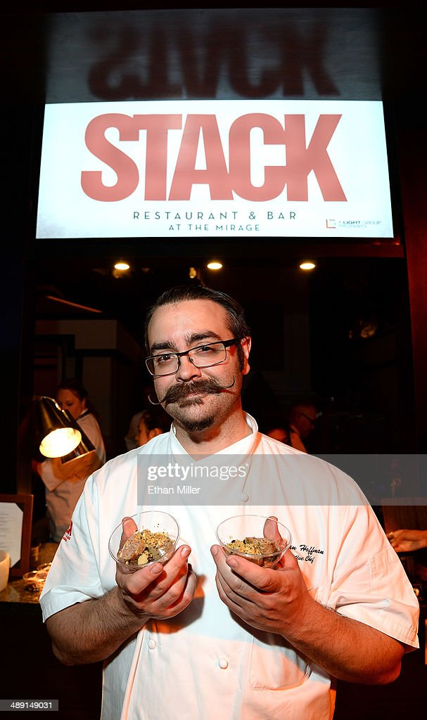 Chef Jordan Hoffman displays pork and veal country sausage dishes at the Stack Restaurant & Bar booth at Vegas Uncork'd by Bon Appetit's Grand Tasting event at Caesars Palace on May 9, 2014 in Las Vegas, Nevada.