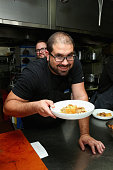 Chef Jose Enrique prepares food at A Dinner With Jose Enrique And Jamie Bissonnette part of the Bank Of America Dinner Series during Food Network...