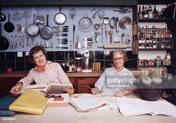 Chef Julia Child and author Simone Beck pose in the kitchen of Child's house La Pitchoune during a photo shoot for McCall's Magazine on June 29 1970...