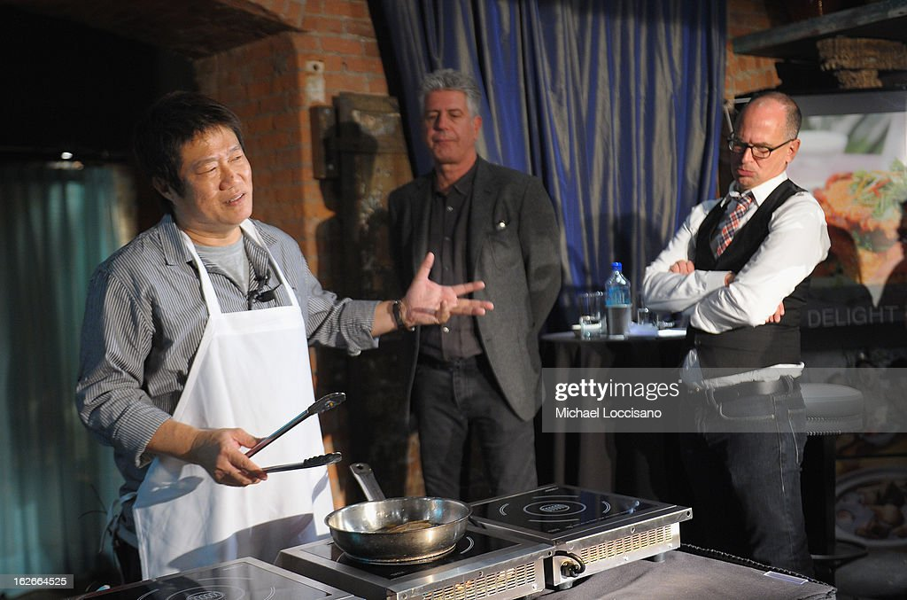 Chef K.F. Seetoh (L) cooks for attendees while Chef <a gi-track='captionPersonalityLinkClicked' href=/galleries/search?phrase=Anthony+Bourdain&family=editorial&specificpeople=2310617 ng-click='$event.stopPropagation()'>Anthony Bourdain</a> (C) and Saveur magazine editor-in-chief James Oseland look on during the press conference announcing the Inaugural World Street Food Congress 2013 at Spice Market on February 25, 2013 in New York City.