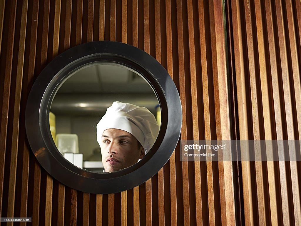 Keywords & Waitress Looking At Chef In Kitchen Door Window Stock Photo ... pezcame.com