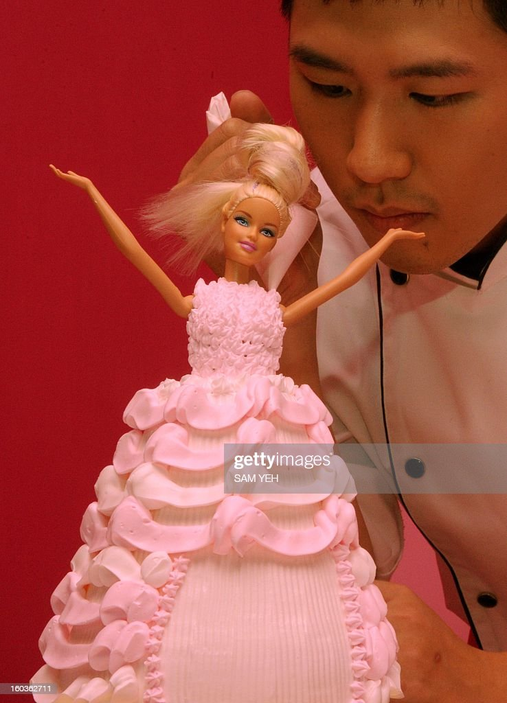 YOUTUBE== (FILES)- A chef makes a Barbie doll themed cake during the opening ceremony of a Barbie-themed restaurant in Taipei on January 30, 2013. With hot pink sofas, high heels-shaped tables and chairs decorated with tutus, the first Barbie-themed restaurant opened in Taiwan on January 30 catering to fans of the iconic doll. AFP PHOTO / Sam Yeh