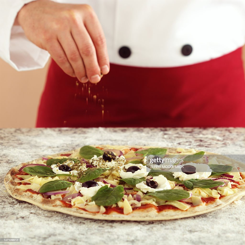 Chef making a pizza : Stock Photo