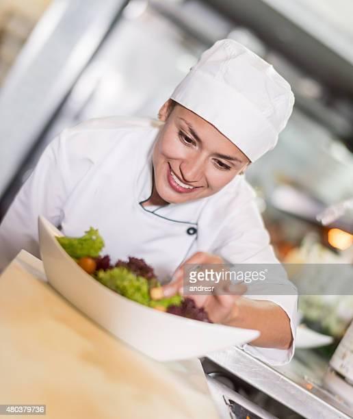 Chef making a salad at a restaurant