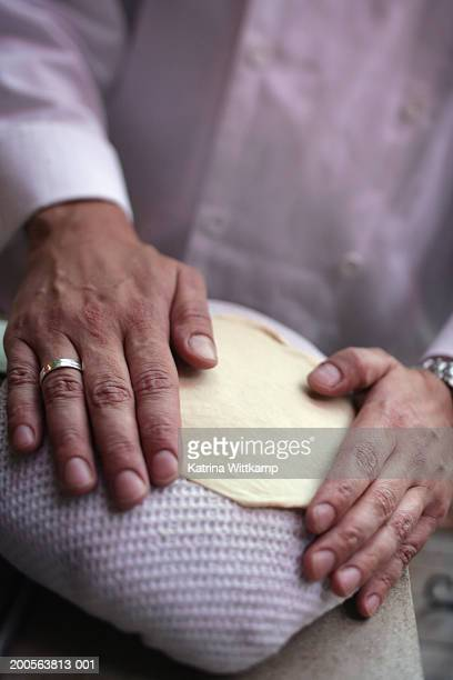 Chef making naan bread, close-up of hands