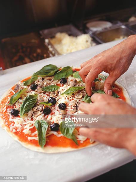 Chef making pizza on table, close-up