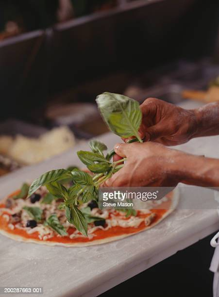 Chef making pizza on table, elevated view