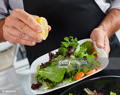 Chef man cooking in the kitchen. : Stock Photo