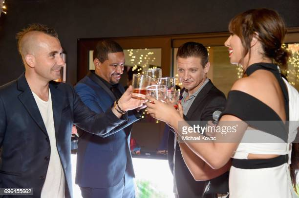 Chef Marc Forgione and actors Laz Alonso Jeremy Renner and Jackie Cruz cheers at Remy Martin's special evening with Jeremy Renner and Fetty Wap...