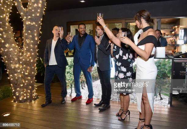 Chef Marc Forgione and actors Laz Alonso Jeremy Renner Remy Martin VP of Marketing Emma Medina and actor Jackie Cruz cheers at Remy Martin's special...