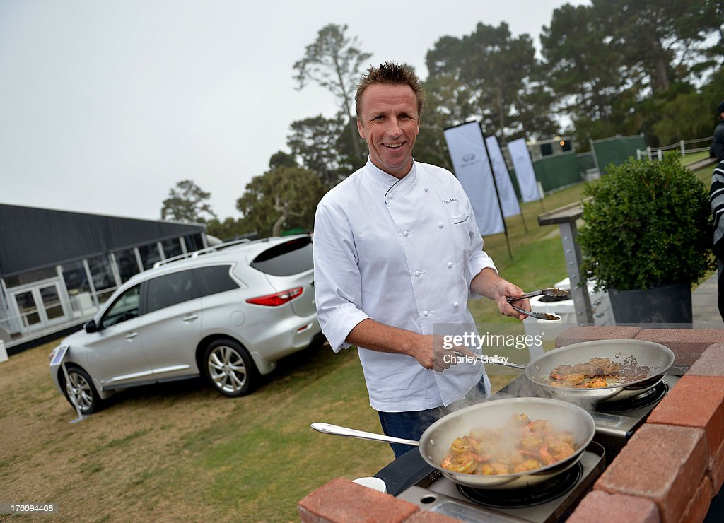Chef Marc Murphy prepares food during day 2 of Moments of Inspiration presented by Infiniti in partnership with Hearst Magazines on August 16, 2013 in Pebble Beach, California.