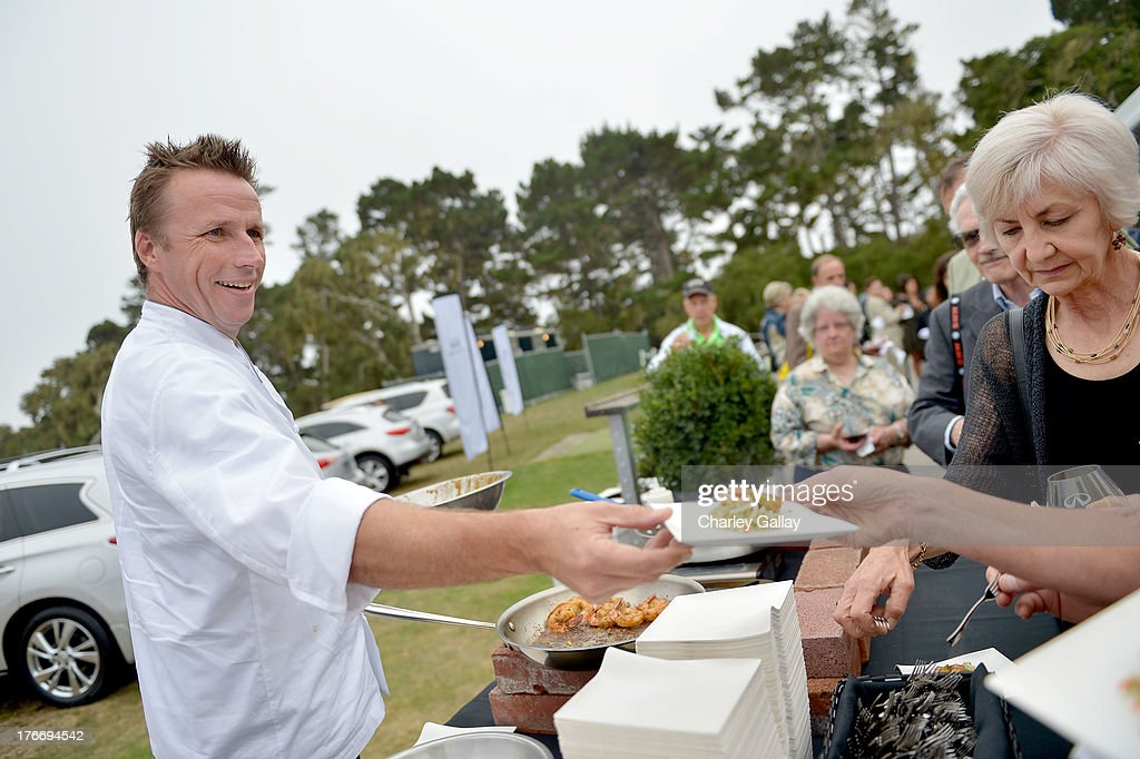 Chef Marc Murphy (L) prepares food during day 2 of Moments of Inspiration presented by Infiniti in partnership with Hearst Magazines on August 16, 2013 in Pebble Beach, California.