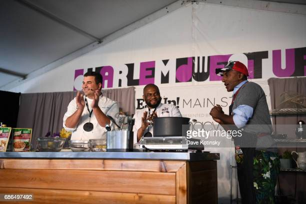 Chef Marcus Samuelsson asnd Chef Chris Bilyk perform onstage at Harlem EatUp's Third Annual Festival Weekend on May 21 2017 in New York City