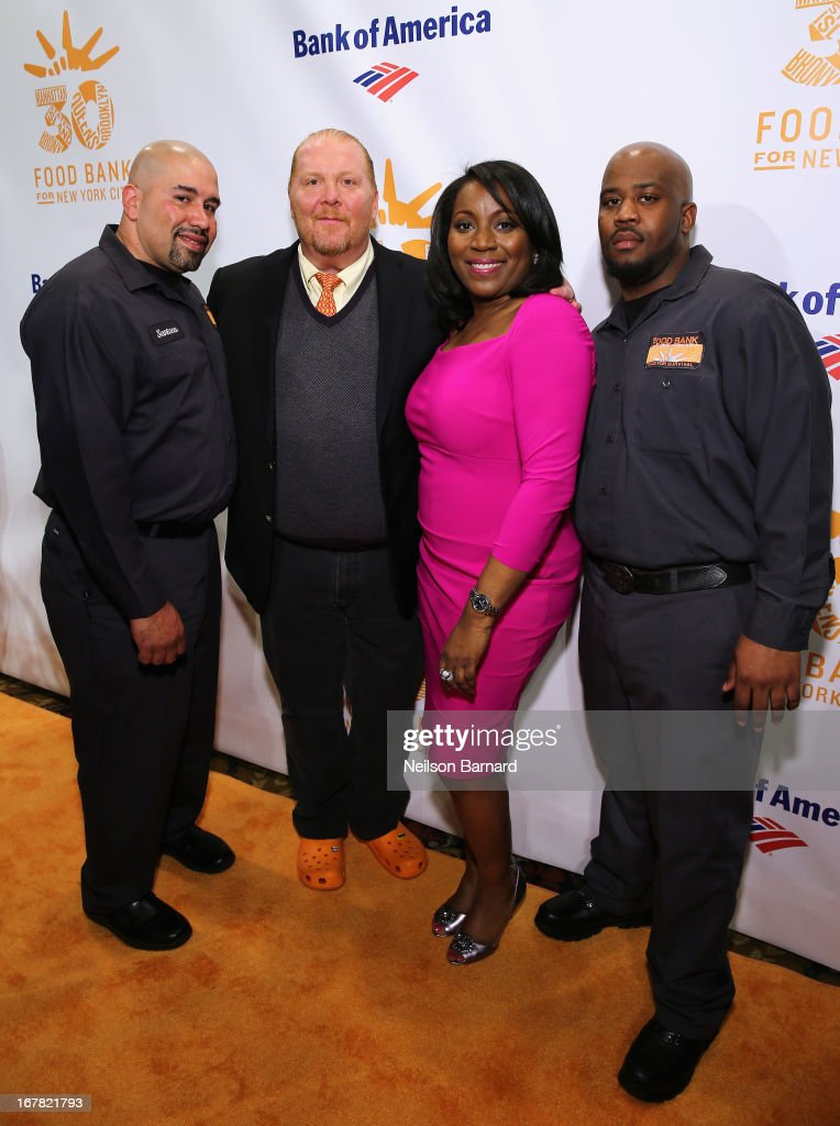 Chef <a gi-track='captionPersonalityLinkClicked' href=/galleries/search?phrase=Mario+Batali&family=editorial&specificpeople=669889 ng-click='$event.stopPropagation()'>Mario Batali</a> and Margarette Purvis, President and CEO of Food Bank for New York City pose with Santana (L) and Hace (R) from Food Bank For New York City at the Food Bank For New York City's Can-Do Awards celebrating 30 years of service to NYC on April 30, 2013 in New York City.