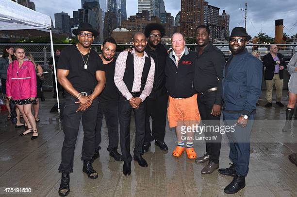 Chef Mario Batali poses with The Legendary Roots Crew at the Infiniti presents The Supper to launch EAT DRINK SAVE LIVES on May 31 2015 in New York...