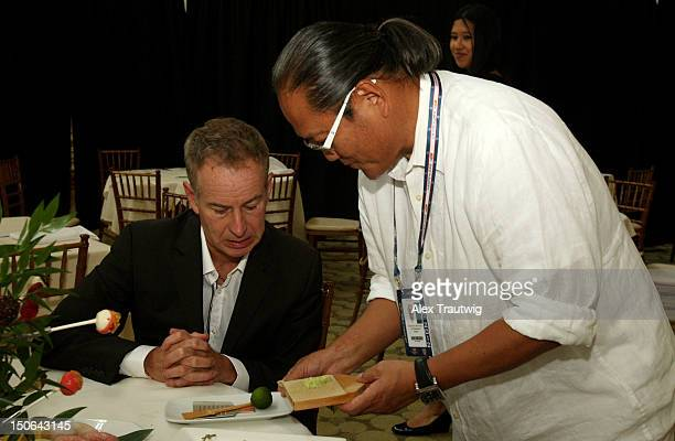 Chef Masaharu Morimoto serves John McEnroe during a food tasting prior to the start of the 2012 US Open at the USTA Billie Jean King National Tennis...
