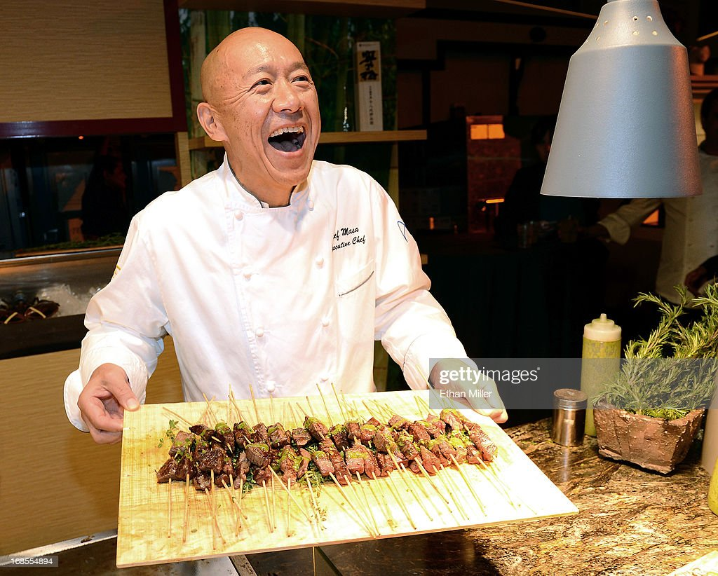 Chef Masayoshi Takayama serves Australian double black label beef skewers at the Tetsu booth at Vegas Uncork'd by Bon Appetit's Grand Tasting event at Caesars Palace on May 10, 2013 in Las Vegas, Nevada.