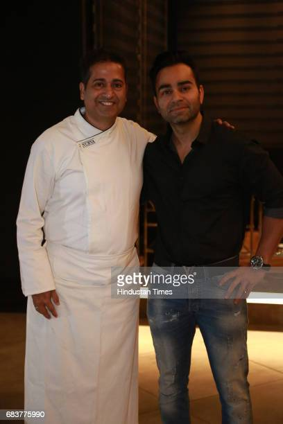 Chef Michael Swamy with Vikas Kohli brother of Virat Kohli during special dinner for Royal Challengers Bangalore teammates by Virat Kohli at his new...