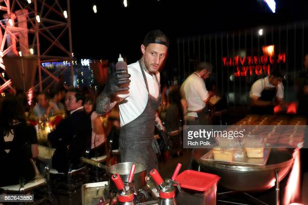 Chef Michael Voltaggio prepares desert at the Capital One Celebration of the launch of the new SavorSM during A Priceless Table presented by...